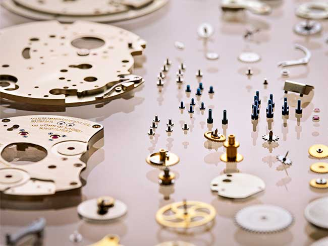 Screws, wheels, and movement parts of an A. Lange & Söhne timepiece