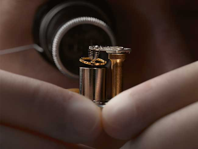 An A. Lange & Söhne watchmaker carefully assembles the small parts of a movement.