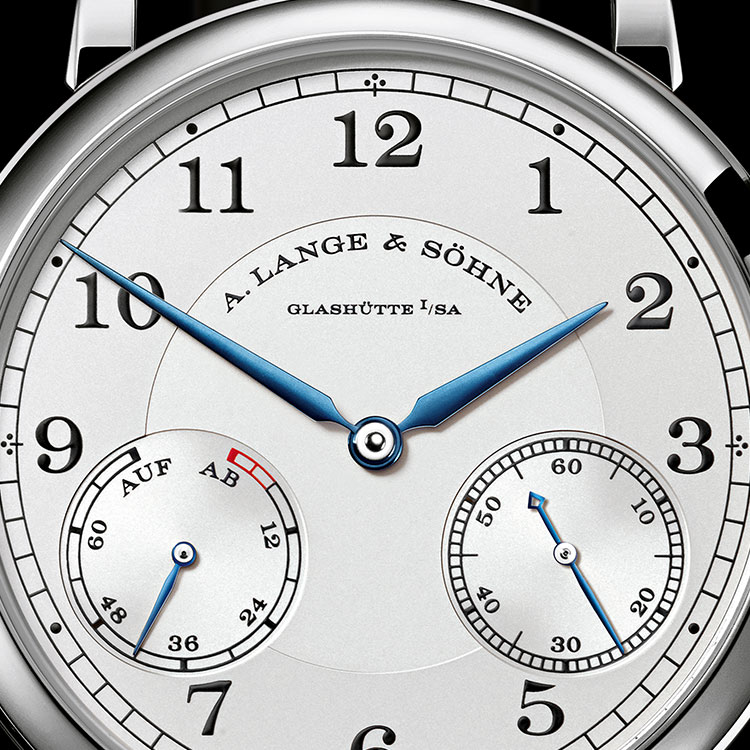 The 1815 UP/DOWN timepiece in white gold features blued hands and a railway-track minute scale.