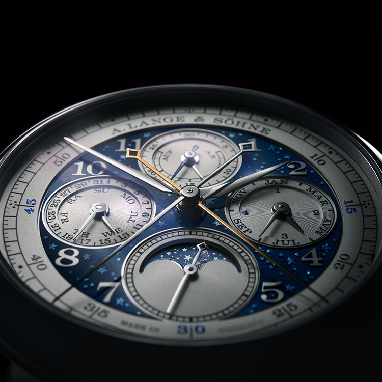 A close-up of the engraved stars under dark blue enamel on the dial of the 1815 RATTRAPANTE PERPETUAL CALENDAR HANDWERKSKUNST.
