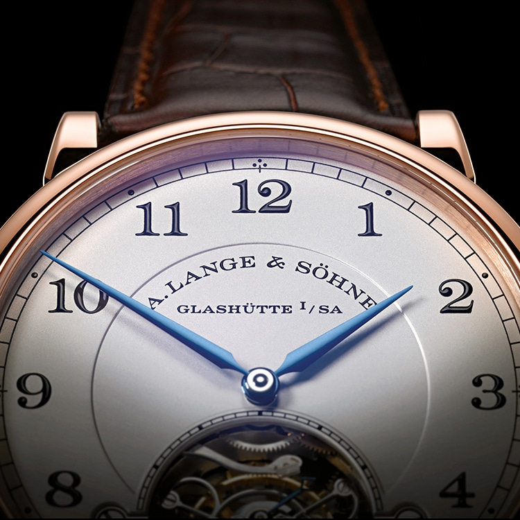 This front view of the 1815 TOURBILLON in pink gold shows the blued hands