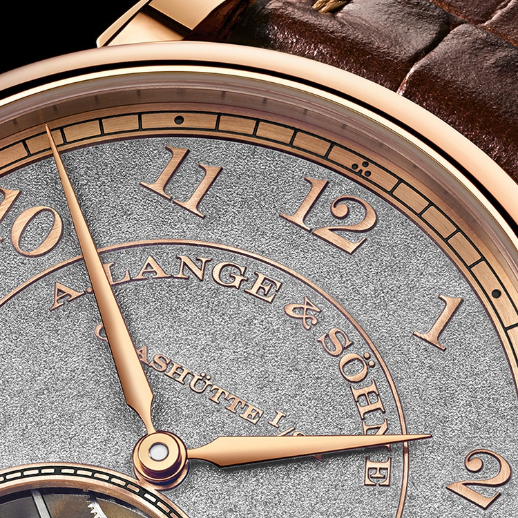 The deail of the 1815 TOURBILLON HANDWERKSKUNST is made of black-rhodiumed pink gold and features an elaborate tremblage engraving technique
