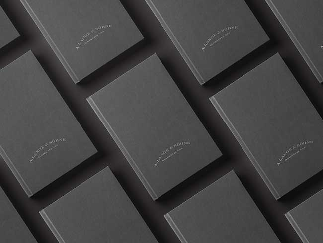 Application documents for the F.A. Lange Watchmaking Excellence Award in grey with the embossed A. Lange & Söhne logo