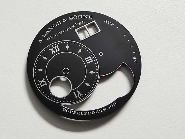 A black enamelled dial