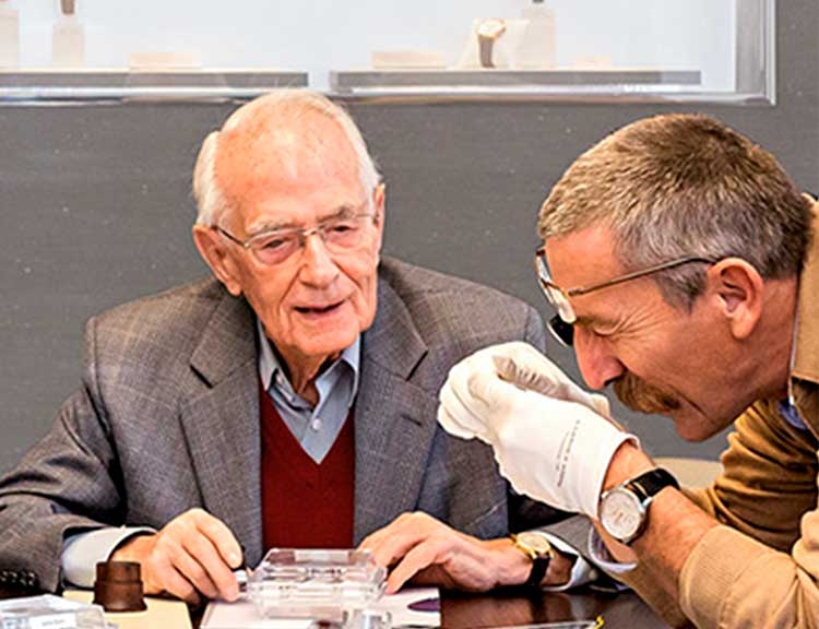 Walter Lange and other members of the judging panel of the Watchmaking Excellence Award in conversation at a large table
