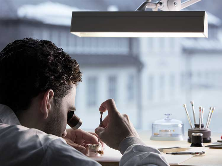 A watchmaker secures a blued screw in an A. Lange & Söhne manufacture movement