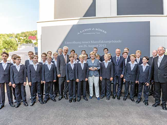 Members of the Dresden Kreuzchor with German Chancellor Angela Merkel
