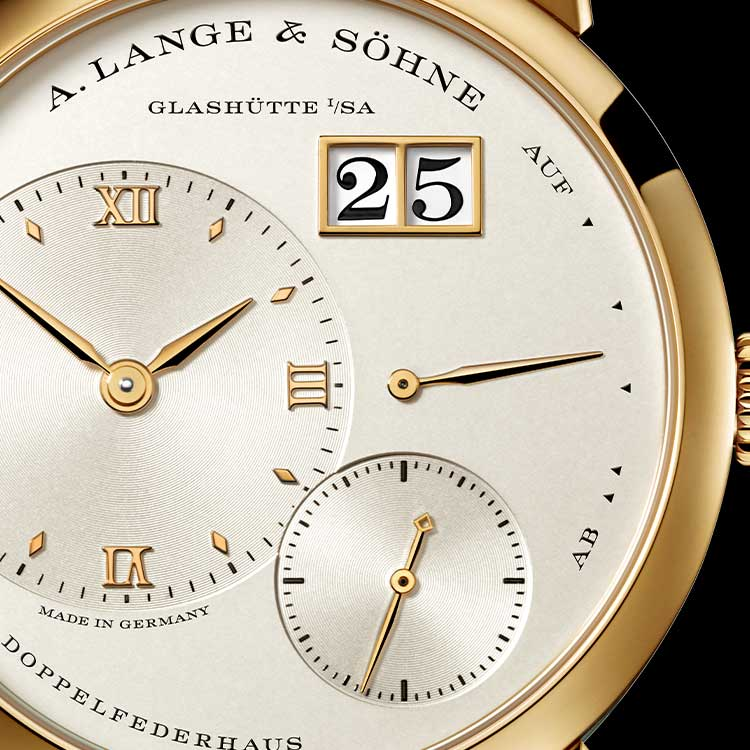 The familiar dial of the LANGE 1 features an outsize date and prominent power reserve indicator
