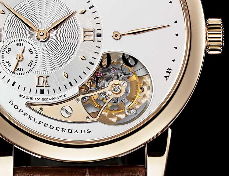 Dial of the LANGE 1 TOURBILLON in pink gold with a focus on the twin mainspring barrel