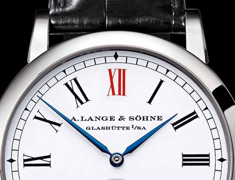 Dial of the ANNIVERSARY LANGEMATIK in platinum with a focus on the red XII