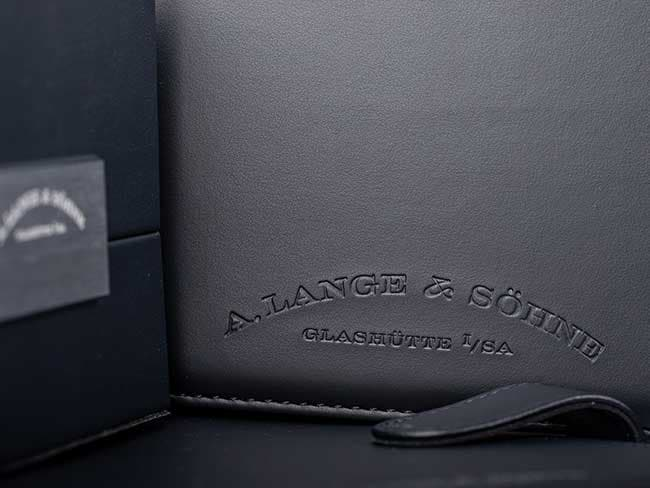 "The ""History of Your Watch"" booklet with an embossed A. Lange & Söhne logo"