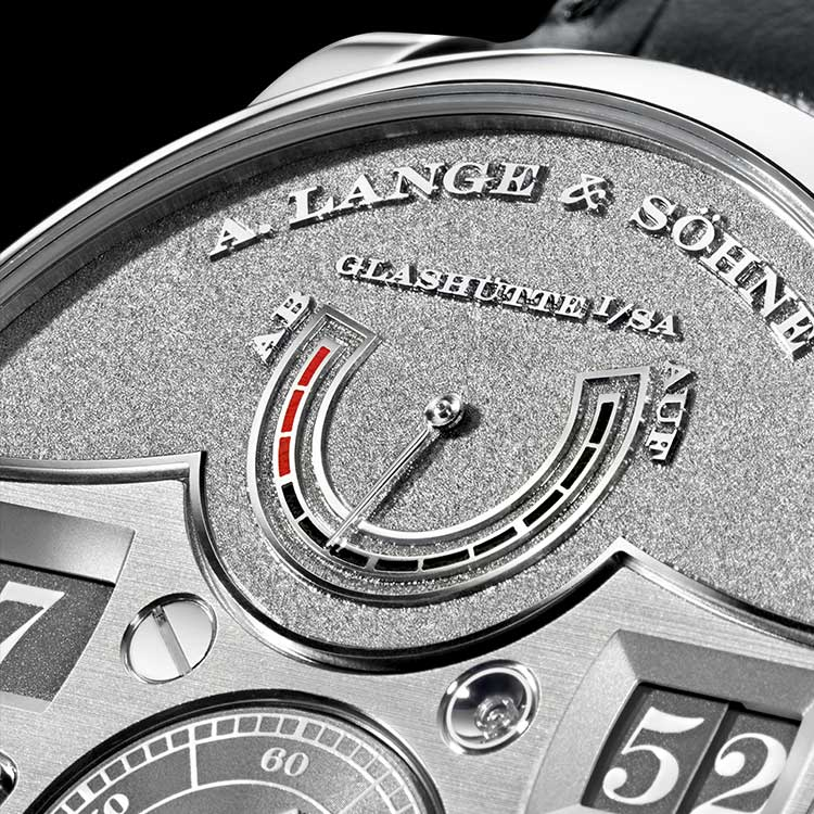 Features of the  ZEITWERK HANDWERKSKUNST: jumping numerals display hour and minute, small second hand with stop seconds, UP/DOWN power reserve indicator, 36-hour power reserve.