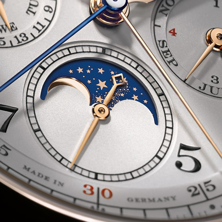 This close-up of the 1815 RATTRAPANTE PERPETUAL CALENDAR in pink gold shows the moon disc, power reserve indicator and perpetual calendar.