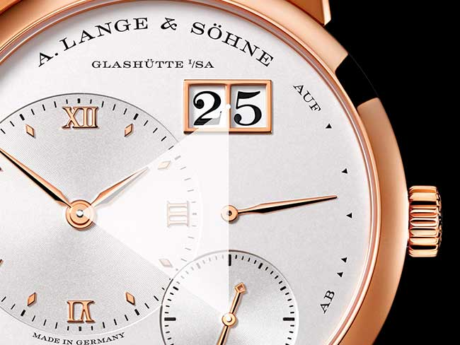 LANGE 1 in red gold with schematic illustration of the decentralised dial