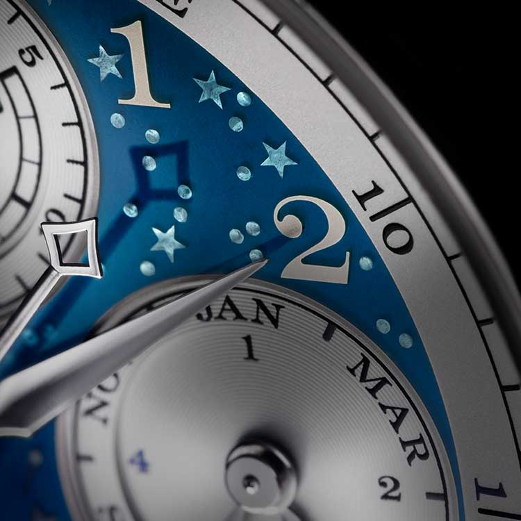 The engraved stars beneath the deep-blue enamel on the 1815 RATTRAPANTE PERPETUAL CALENDAR HANDWERKSKUNST in close-up.