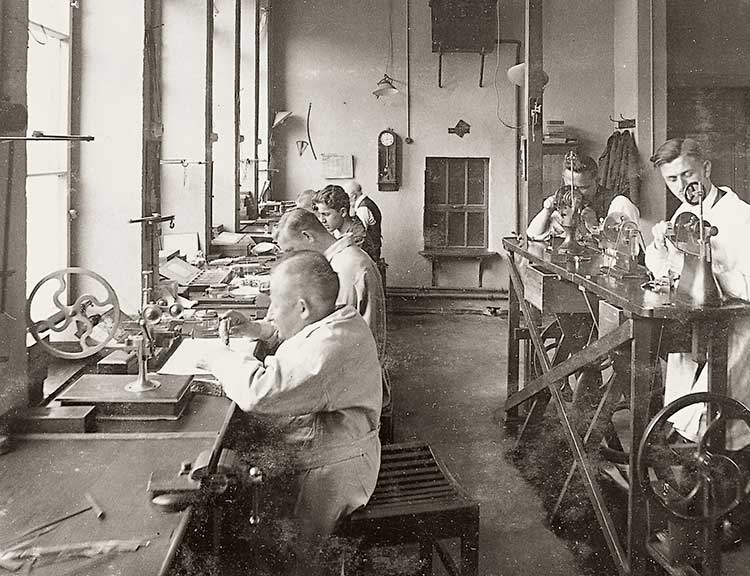 Ferdinand Adolph Lange trains 15 apprentices in the art of watchmaking
