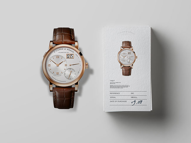 Guarantee documents for a Lange timepiece on a white background