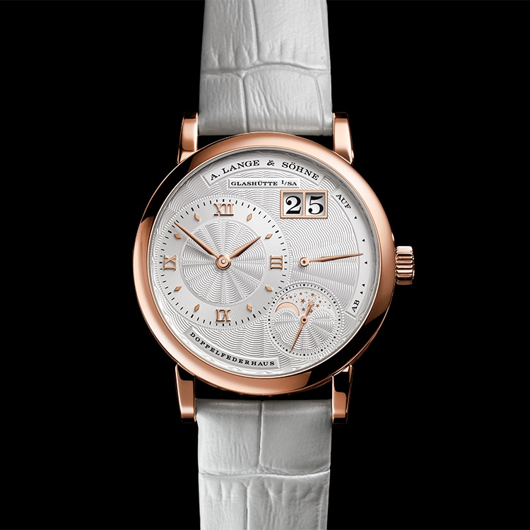The LITTLE LANGE 1 MOON PHASE with guilloched, argenté-coloured dial in a 36.8-millimetre pink gold case.