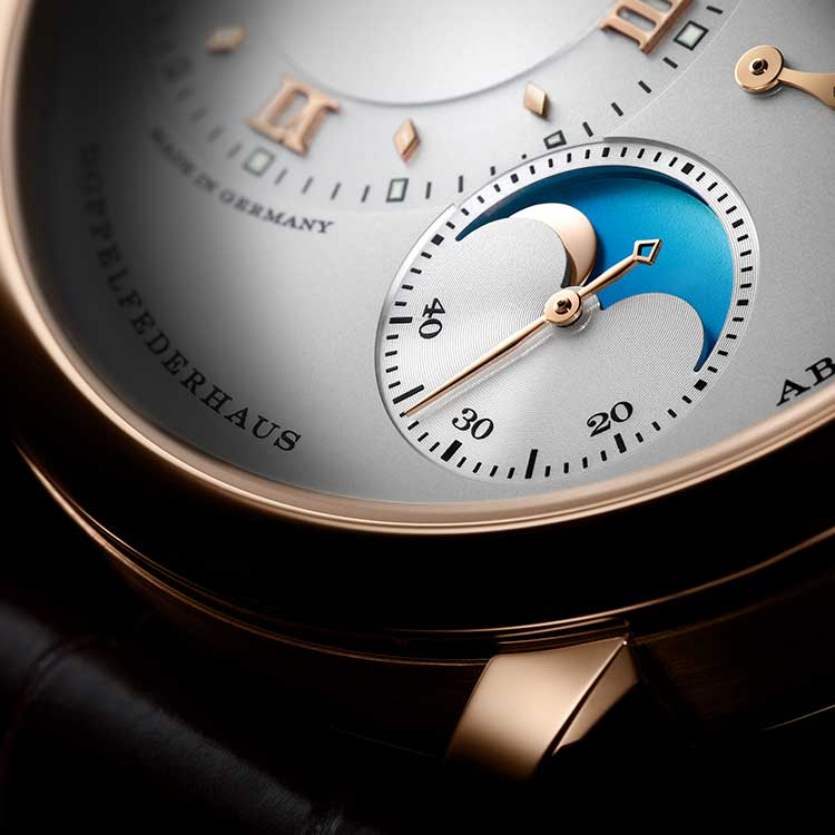 In the LANGE 1 MOON PHASE, the moon moves in front of a bright-blue celestial disc without stars during the day.