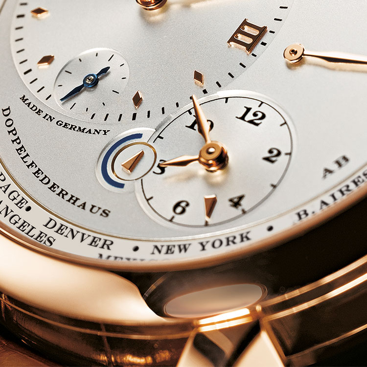 In the LANGE 1 TIME ZONE, the smaller numerals scale indicates the time in a second zone.