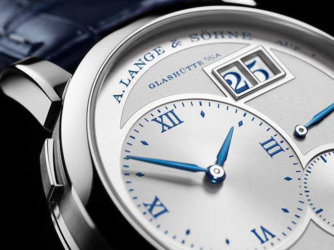"LANGE 1 ""25th Anniversary"" in white gold with blued steel hands and blue number indicators"