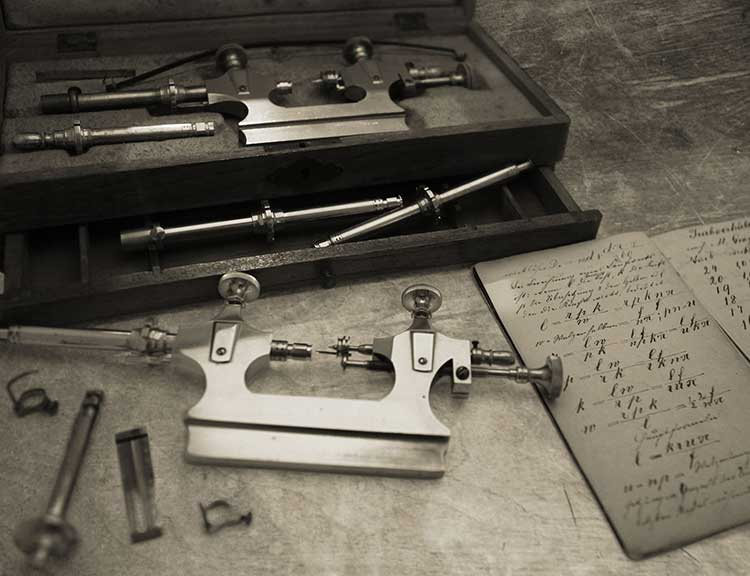 Watchmaker's instruments and notes on a workbench