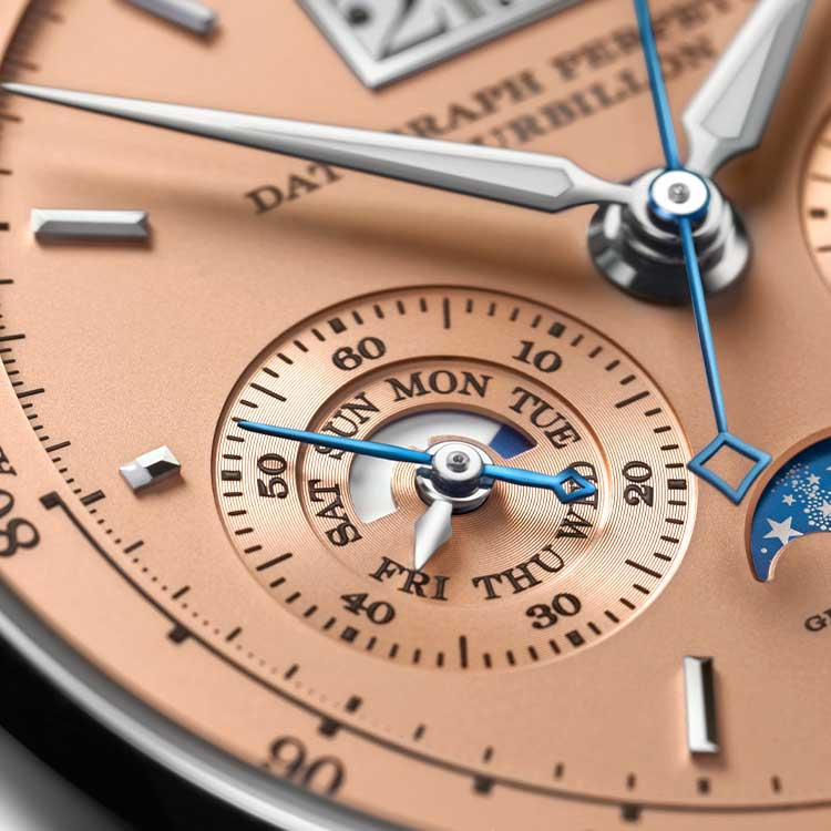 Display of the weekdays on the pink gold dial of the DATOGRAPH PERPETUAL TOURBILLON