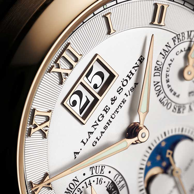 The outsize date is located in the LANGEMATIK PERPETUAL directly below the number 12.