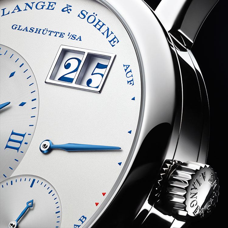 "Dial close-up of the LITTLE LANGE 1 ""25th Anniversary"" in white gold with blued hands and a blue printed dial."