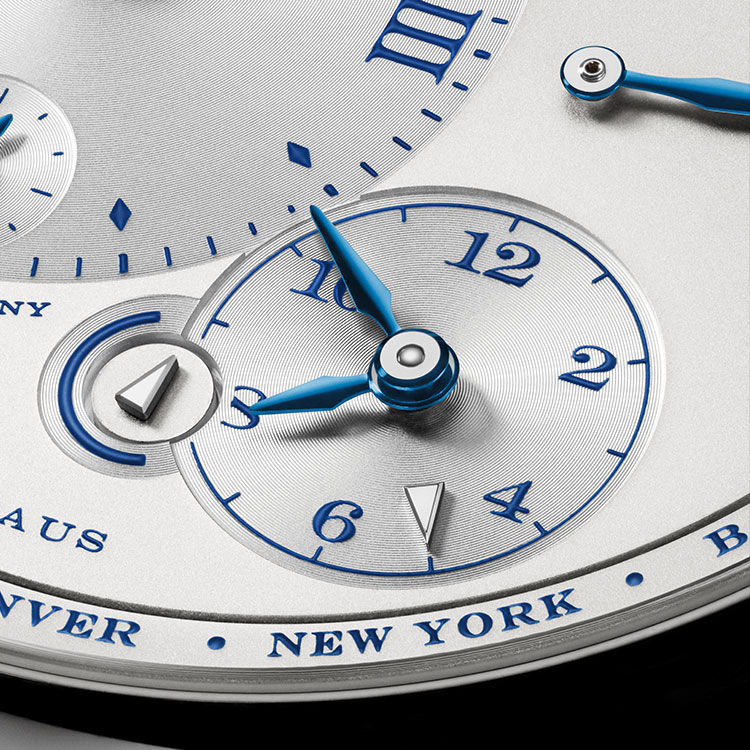 "The LANGE 1 TIME ZONE ""25th Anniversary"" makes it easy to ascertain the time in all 24 time zones, while simultaneously keeping abreast of the time at home."