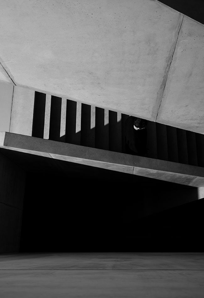 Black and white photography of a modern concrete staircase. Clemens Poloczek for A. Lange & Söhne.