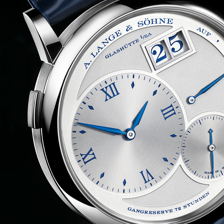 "Dial detail of the GRAND LANGE 1 ""25th Anniversary"" in white gold with blued hands and a blue printed dial."