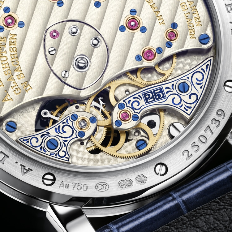 "Close-up of the hand-engraved tourbillon bridge and intermediate-wheel cock of the LANGE 1 TOUBILLON ""25th Anniversary""."